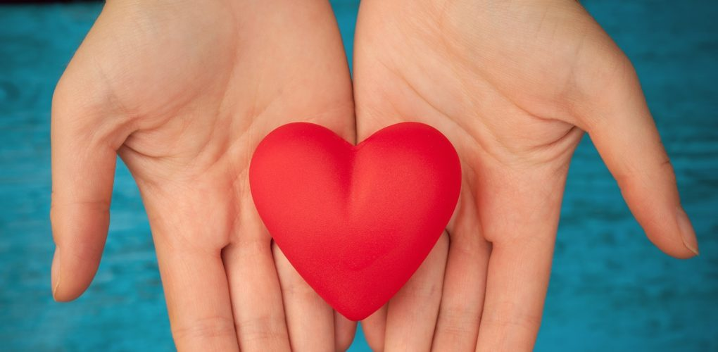 Hands representing a healthy heart during American Heart Month