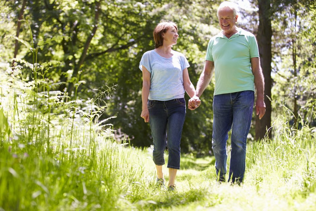 Seniors staying safe on a walk knowing fall prevention tips