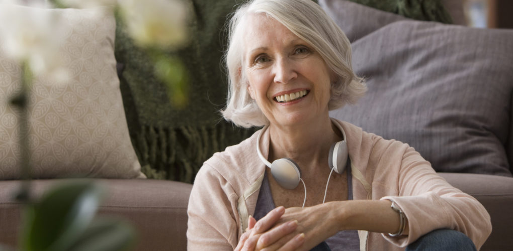 Portrait of woman sitting with headphones