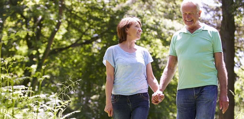 Senior Couple Walking In Summer Countryside