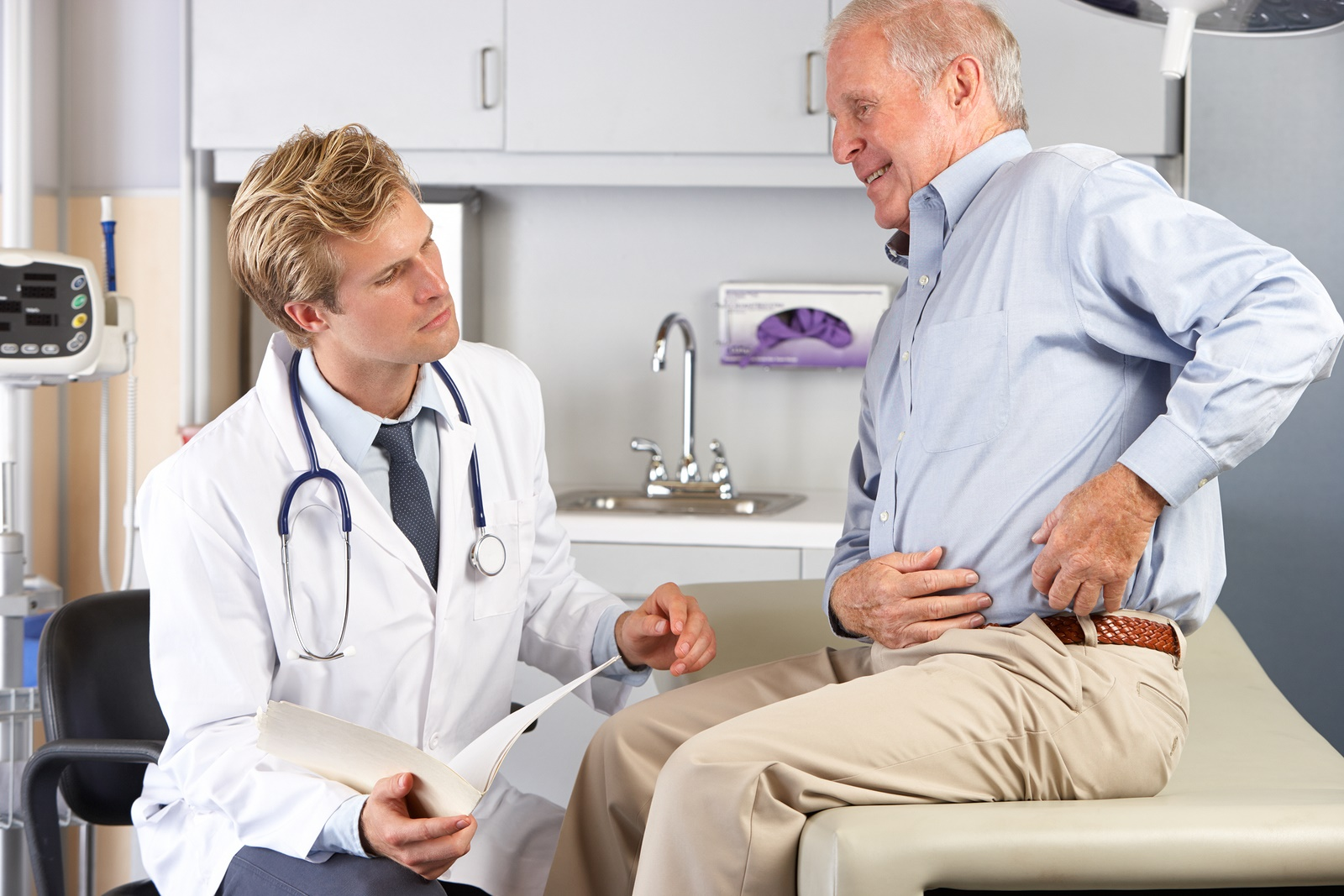 Senior discussing hip replacement surgery with his physician