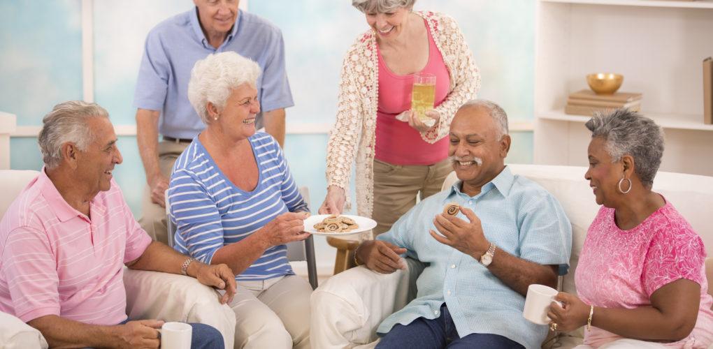 Seniors socializing and enjoying their senior living community