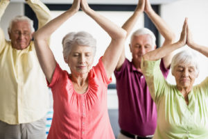 Exercise for seniors in the winter includes a variety of engaging activities like yoga